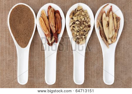 Liquorice chinese herbal medicine including powder, honey coated, chopped and sliced root. Left to right.
