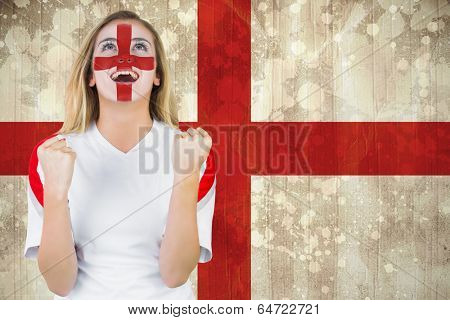 Excited fan england in face paint cheering against england flag in grunge effect poster