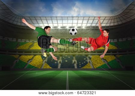 Football players tackling for the ball against large football stadium with brasilian fans