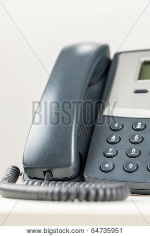 Cropped view of classic landline telephone. Over white background. poster