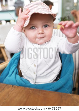 Baby At Table In Restaurant
