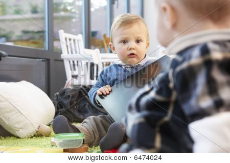 Two Babies On A Living Room Floor
