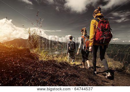 Group of hikers walking on the caldera of volcano of Batur, Bali, Indonesia