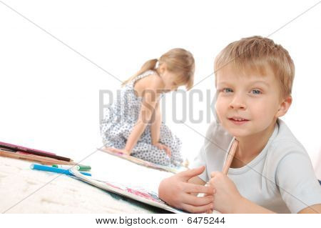 Children Drawing And Reading