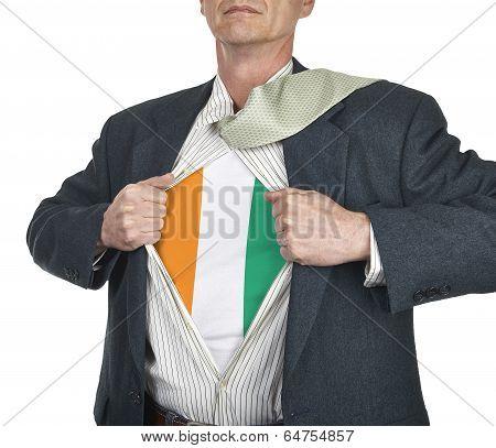 Businessman Showing Ivory Coast Flag Superhero Suit Underneath His Shi