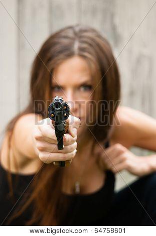 Brunette Woman Points Gun Spent Chamber Ready To Fire
