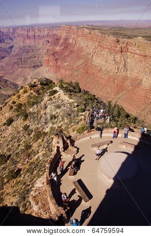 Tourists On The Watchtower Platform Gaze At The Canyon