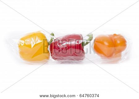 Fresh Paprika Isolated On White Background In A Transparent Bag Ready To Sell
