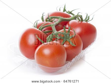 Fresh Tomatoes Isolated On White Background In Transparant Tray