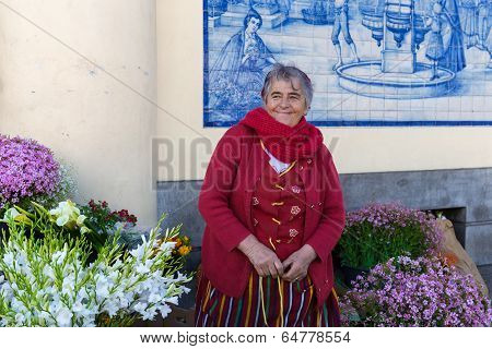 Ttraditional Woman Sells Flowers At A Market Of Funchal, Portugal