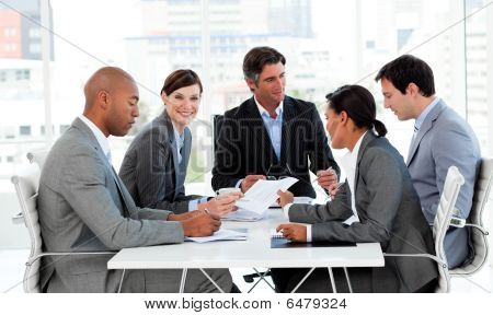 Multi-ethnic Business People Disscussing A Budget Plan