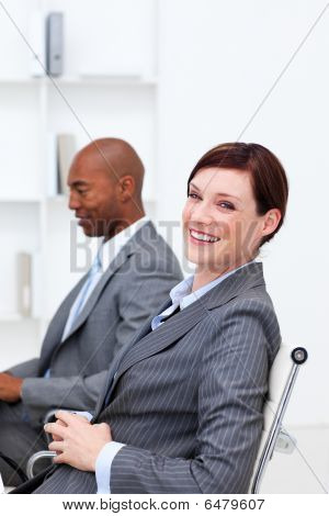 Portrait Of Two Smiling Multi-ethnic Colleagues