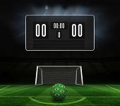 Football in brazilian colours and scoreboard against football pitch and goal under spotlights poster
