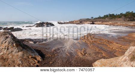 Surf Eroding Coastal Rocks