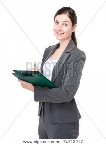 Businesswoman write on clipbaord