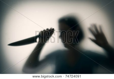Shadowy figure of woman-killer with a knife behind glass  poster