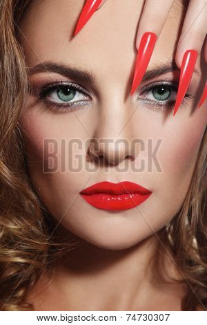 Close-up portrait of young beautiful woman with red lipstick and long stiletto nails poster