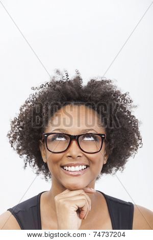 A beautiful intelligent mixed race African American girl or young woman looking up happy  smiling and wearing geek glasses