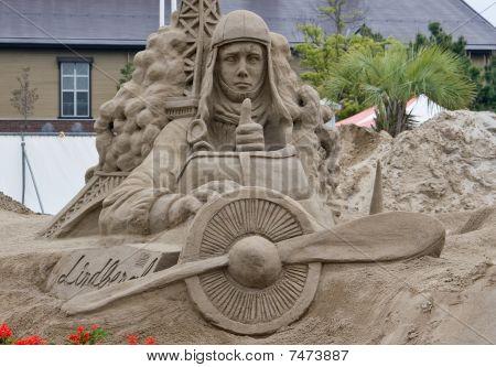 Sandsculpture of Charles Lindbergh in his airplane