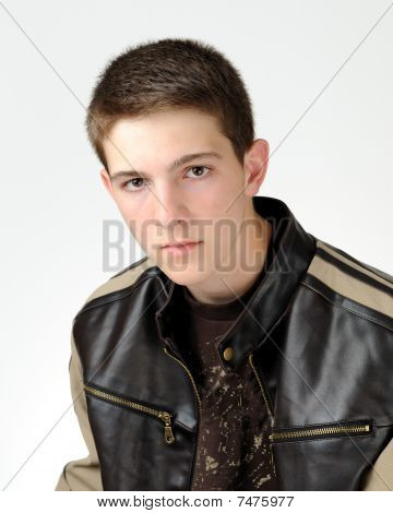 Teenage caucasian boy in leather jacket