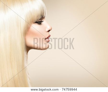Blond Hair. Blonde Beauty girl with long smooth shiny hair. Fringe Haircut. Beautiful Girl with Healthy Long Hair. Hairstyle