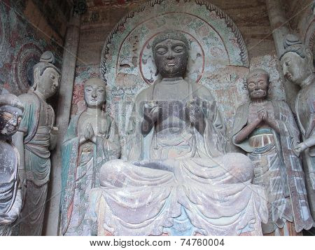 Buddha and his suppliers in a cave