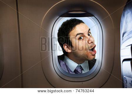 Businessman looking  through an airplane window