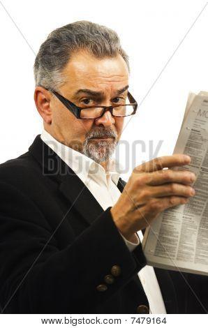 Older Businessman Reads His Newspaper.