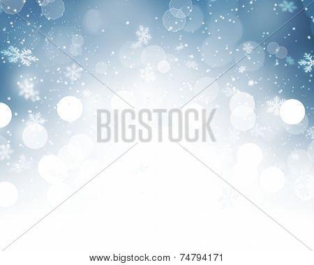 Christmas Background. Winter Holiday Snow Blue Background with snowflakes and stars. Christmas Abstract Defocused Blurred Glowing Backdrop. Elegant Bokeh