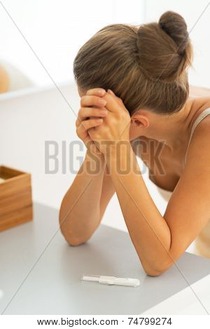 Portrait Of Frustrated Young Woman With Pregnancy Test