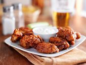 boneless buffalo bbq chicken wngs with ranch sauce and beer poster