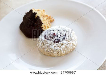 Linzer Cookie And Coconut Macaroon Dipped In Chocolate
