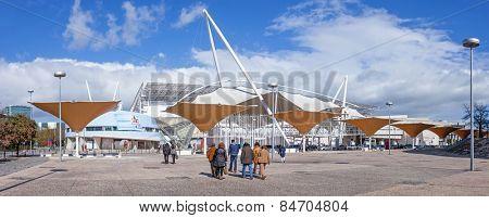 Lisbon, Portugal - February 01, 2015: Visitors going to an exhibition in FIL (Feira Internacional de Lisboa / International Fair of Lisbon) in Parque das Nacoes (Park of Nations)
