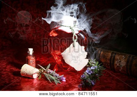 Pretty Poison. A Witches Brew boils and bubbles in a heart shaped bottle, with Skull and Cross Bones on the label, Book of Spells and Recipes, along with on the walls in this spooky image.