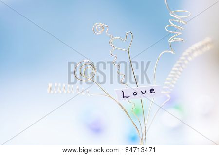 Expanding love. love expressed with gold wires. Intentionally shot with shallow depth of field.