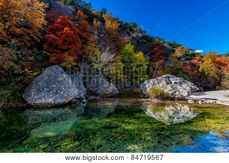 Clear Pond, Boulders, and Fall Foliage at Lost Maples State Park, Texas