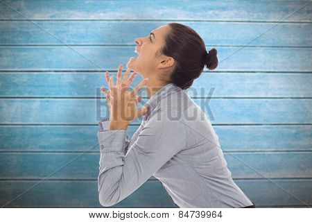 Frustrated businesswoman shouting against wooden planks poster