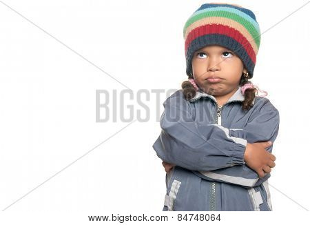 Angry little multiracial girl isolated on a white background
