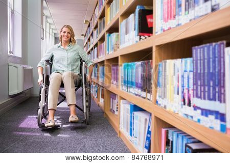 Smiling disabled student in library at the university poster
