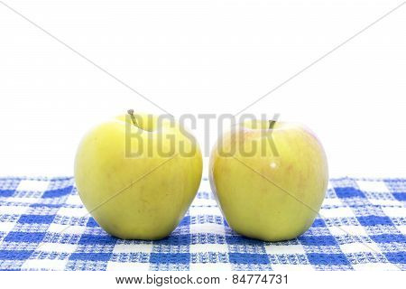 Fresh Yellow Apple Fruit On Blue Tablemat