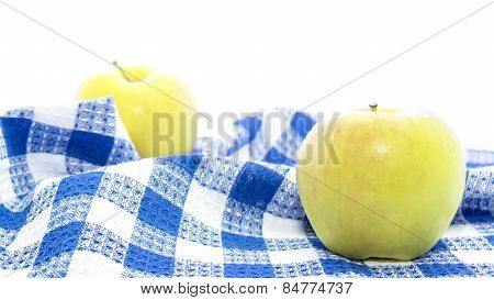 Fresh Yellow Apple Healthy Fruit On Folded Blue Tablemat
