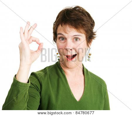 Pretty, mature woman with a pixie cut smiles and gives the Okay hand sign.  Isolated on white.