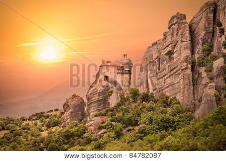 Holy Monastery of Saint Nicholas Anapausas in sunset at Meteora, Greece. Meteora are Orthodox 6 monasteries complex built on natural sandstone rock pillars.