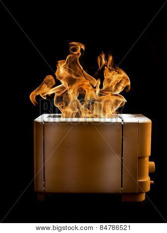 Toaster with two slices of toast caught on fire over black background poster
