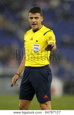BARCELONA - JAN, 22: Referee Jesus Gil Manzano declaring a foul during a Spanish League match between Espanyol and Sevilla FC at the Estadi Cornella on January 22, 2015 in Barcelona, Spain