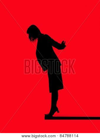 Silhouette of a woman close to fall down isolated on red background