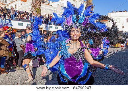Sesimbra, Portugal. February 17, 2015: Samba dancers members of the Ala Section, in the Rio de Janeiro Brazilian style Carnaval Parade.