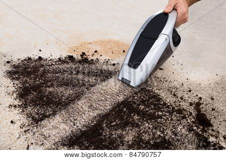 Person Vacuuming On Carpet