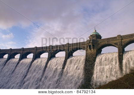Hafren Dam in Mid-Wales with water overflowing