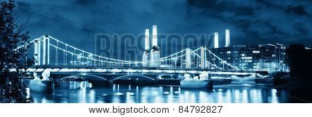 Battersea Power Station panorama over Thames river as the famous London landmark at night. poster